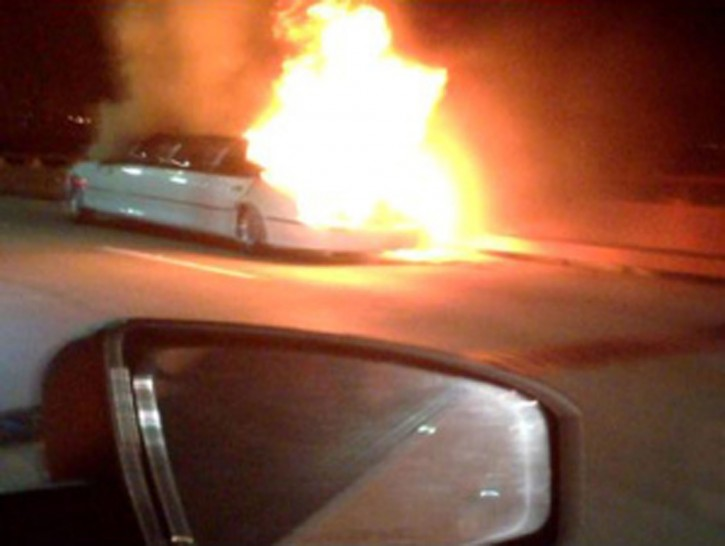 This frame grab taken from video provided by Roxana and Carlos Guzman shows a Limo on fire Saturday, May 4, 2013, on the San Mateo-Hayward Bridge in San Francisco. (AP Photo/Roxana and Carlos Guzman)