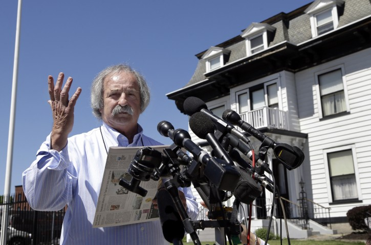 "Worcester activist William Breault speaks at a news conference outside the Graham, Putnam & Mahoney Funeral Parlors in Worcester, Mass., Monday, May 6, 2013, where the body of killed Boston Marathon bombing suspect Tamerlan Tsarnaev is being prepared for burial. Funeral director Peter Stefan has pleaded for government officials to use their influence to convince a cemetery to bury Tsarnaev, but so far no state or federal authorities have stepped forward. Breault said he has started a ""Body Transportation Fund"" with the objective of flying Tsarnaev's body to Dagestan. (AP Photo/Elise Amendola)"