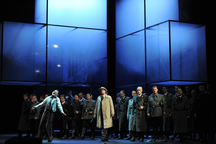 "The photo provided by Deutsche Oper am Rhein in Duesseldorf, western Germany, shows Markus Eiche, left, as Wolfram and Thorsten Gruembel as Landgraf performing in front of the choir in a scene of the the opera 'Tannhaeuser' during the dress rehearsal on April 30, 2013. The modern production of Richard Wagner's opera Tannhauser has caused a stir in Germany because of Nazi-themed scenes showing people dying in gas chambers and a family getting their heads shaved and executed. A spokeswoman for the Duesseldorf opera house said Tuesday that members of the audience ""booed and were shocked"" by Saturday's, May 3, 2013 opening performance. (AP Photo/Deutsche Oper am Rhein, Hans Joerg Michel)"