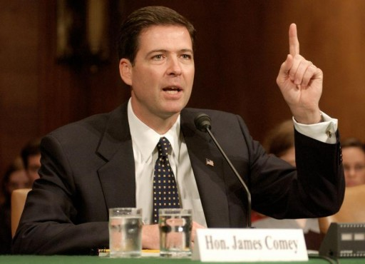 FILE PHOTO - James Comey, testifies before the Judiciary Committee on Capitol Hill in Washington, D.C., October 29, 2003. REUTERS/Mannie Garcia