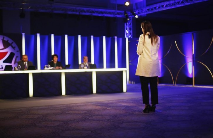 "A contestant stands in front of the judges during the taping of the new local game show ""The President"" in a luxury hotel in the West Bank city of Ramallah April 23, 2013. The show aims to select a ""new leader"" for the Palestinians based on the young contestants' views on the pressing political issues of the day. It's a rare chance for a frustrated and marginalized generation to air their views. While Palestinian politics may be in a moribund condition at the national level, the paralysis has not stifled youthful debate. Picture taken April 23, 2013. To match ISRAEL-PALESTINIANS/YOUTH  REUTERS/Mohamad Torokman"