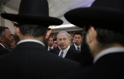 Israeli Prime Minister Benjamin Netanyahu, center, meets rabbis as he visits the Shanghai Jewish Refugees Museum at former site of Ohel Moshe Synagogue in Shanghai, China, Tuesday, May 7, 2013. (AP Photo/Eugene Hoshiko)