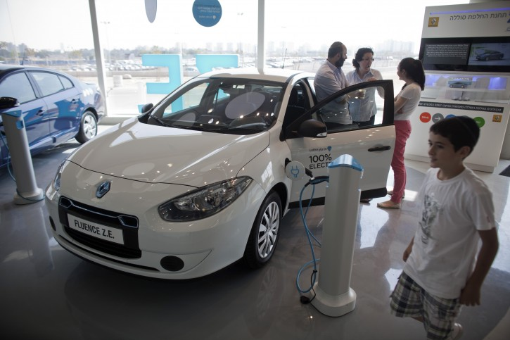 File photo of a family at an electric car of the US-Israeli 'Better Place' company in their showroom in Tel Aviv, Israel, 03 October 2012. EPA/OLIVER WEIKEN