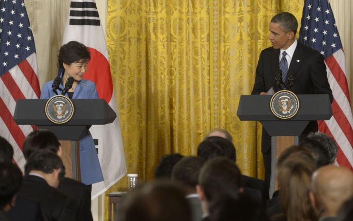 US President Barack Obama (R), with the President of South Korea Park Geun-hye, responds to a question during a joint press conference in the East Room of  the White House in Washington, DC, USA, 07 May 2013. President Park will address a joint meeting of congress tomorrow.  EPA/SHAWN THEW