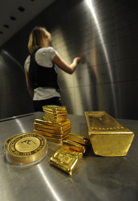 FILE - A picture made available on 01 September 2011 shows an employee of coin and precious metal trader pro aurum opening a safe, while gold bars and gold coins are seen in the foreground, Munich, Germany, on 31 August 2011. EPA