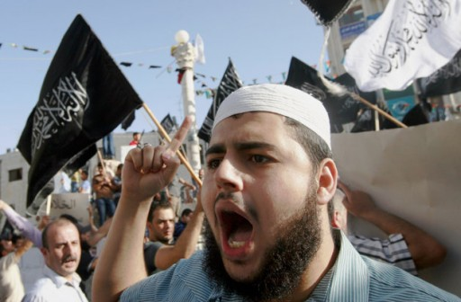 Palestinian supporters of Hizbut-Tahrir, or Party of Liberation, shout slogans during a rally in the West Bank city of Ramallah, Tuesday, June 4, 2013. (AP Photo/Majdi Mohammed)