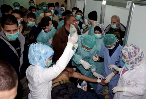 FILE - In this Tuesday, March 19, 2013 file photo released by the Syrian official news agency SANA, a Syrian victim who suffered an alleged chemical attack at Khan al-Assal village according to SANA, receives treatment by doctors at a hospital in Aleppo, Syria. (AP Photo/SANA, File)