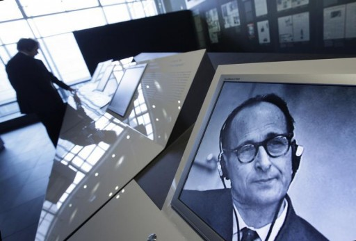 FILE - People look at displays at an exhibition about German Nazi and Holocaust organiser Adolf Eichmann (pictured on screen at R) in Berlin, April 5, 2011.  Reuters
