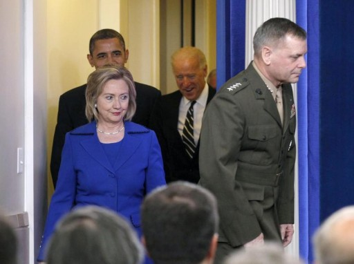 "FILE - U.S. Vice Chairman of the Joint Chiefs of Staff General James E. ""Hoss"" Cartwright (R) and Secretary of State Hillary Clinton lead as U.S. President Barack Obama enters the White House Briefing Room to deliver a statement on the Afghanistan-Pakistan Annual Review in Washington December 16, 2010.  Reuters"