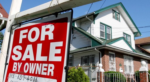 (FILE) A file photo dated  06 June 2007 showing a real estate sign seen in front of a house in Queens, New York.  EPA