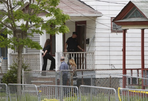 FILE - Law enforcement officials enter a house on Seymour Avenue in Cleveland Ohio, USA, 08 May 2013, where Amanda Berry, Gina DeJesus and Michelle Knight were found alive after having been held hostage for nearly 10 years.  EPA