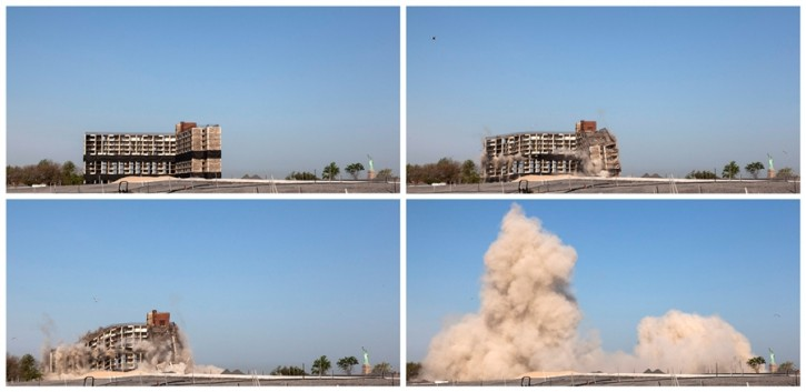 A combination photo shows a brick building being imploded on Governors Island in New York. Zoran Milich / Reuters