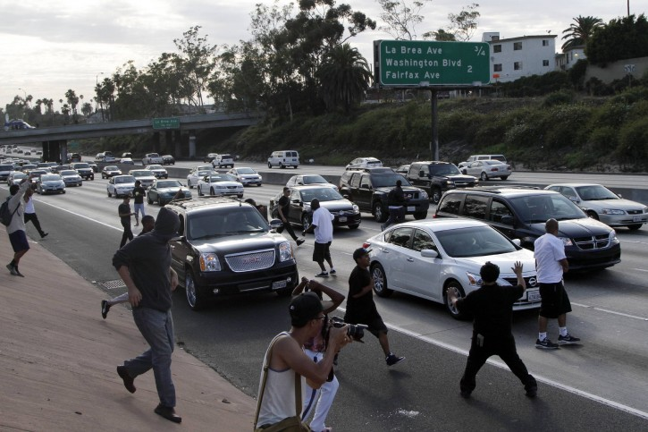 Los angeles protesters block traffic over zimmerman acquittal a crowd of demonstrators block traffic on the interstate 10 freeway while protesting the acquittal of sciox Choice Image