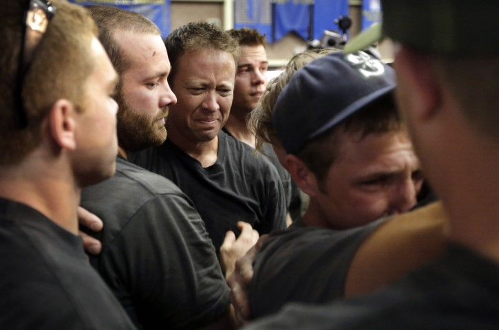 Firefighters gather during a memorial service Monday, July 1, 2013, in Prescott, Ariz., honoring their 19 fellow firefighters killed battling a wildfire near Yarnell, Ariz., Sunday.  The elite crew of firefighters was overtaken by the out-of-control blaze as they tried to protect themselves from the flames under fire-resistant shields. (AP Photo/Chris Carlson)