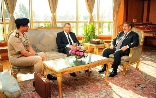 In this file photo Monday, July 1, 2013, Egyptian President Mohammed Morsi, right, meets with Prime Minister Hesham Kandil, center, and Egyptian Minister of Defense, Lt. Gen. Abdel-Fattah el-Sissi, left in Cairo, Egypt. (AP Photo/Egyptian Presidency, File)