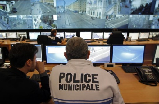 FILE - French municipal policemen look at surveillance screens at the Urban Supervision Centre (CSU) in Marseille, February 8, 2013.  Reuters