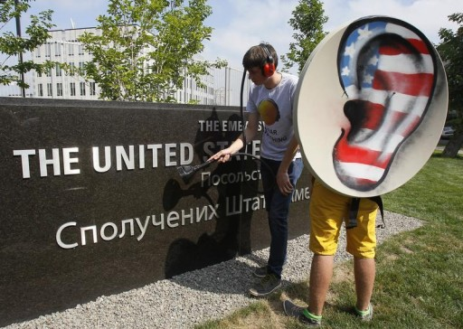 Activists from the Internet Party of Ukraine perform during a rally supporting Edward Snowden, a former contractor at the National Security Agency (NSA), in front of U.S. embassy, in Kiev June 27, 2013. Former U.S. spy agency contractor Snowden was believed to still be at a Moscow airport on Thursday and officials said he had not booked a flight out despite pressure from Russian President Vladimir Putin to leave. REUTERS/Gleb Garanich