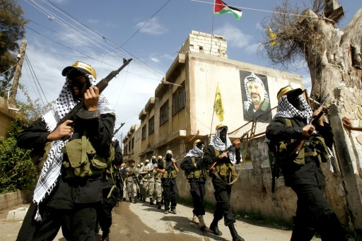 Palestinian Fatah fighters from Al-Aqsa Martyrs Brigades march during a military parade in the Ein El Helweh Palestinian refugee camp, 15 May 2013. EPA/STR
