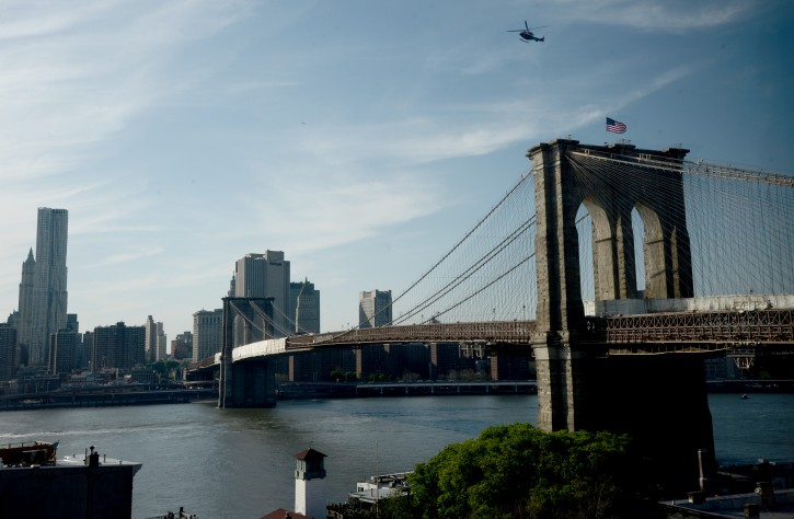 File photo of  a New York Police department helicopter hovering above the Brooklyn Bridge. EPA/ANDREW GOMBERT