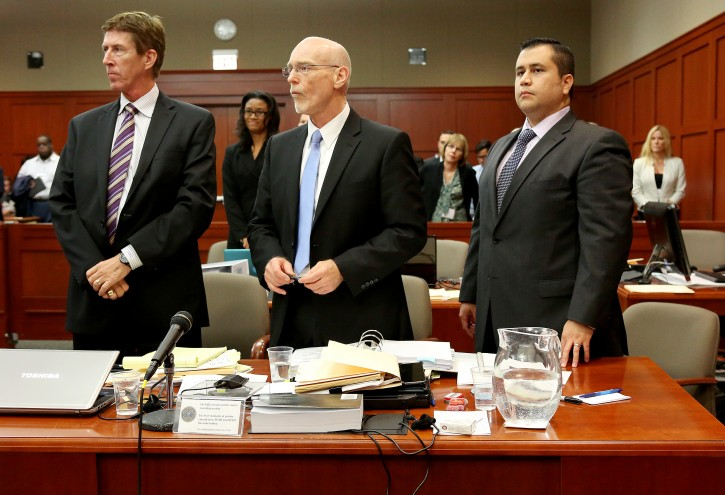 Defense attorneys Mark O'Mara, left, Don West, center, stand with George Zimmerman during Zimmerman's trial in Seminole circuit court, in Sanford, Fla., Wednesday, July 3, 2013. Zimmerman is charged with 2nd-degree murder in the fatal shooting of Trayvon Martin, an unarmed teen, in 2012.  EPA/JACOB LANGSTON / POOL