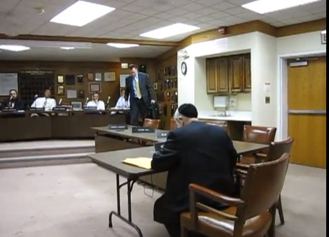 Image grab fro YouTube video where Mr. Kirby is seen leaving the Board meeting room on June 2, 2013 (LuckyLouProduction)