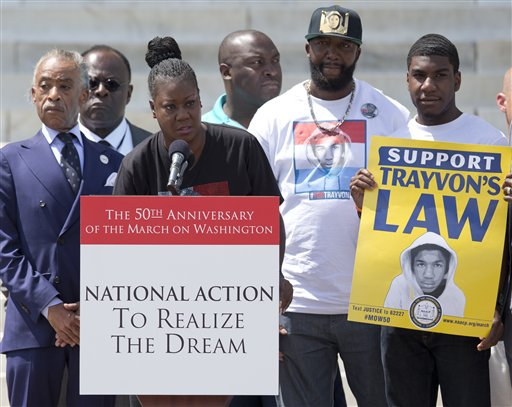 Sabrina Fulton, mother of slain teenager Trayvon Martin, speaks at the podium in front of the Lincoln Memorial in Washington Saturday, Aug. 24, 2013, with Rev. Al Sharpton, left, Tracy Martin, father of Trayvon Martin, second from right, and Jahvaris Fulton, brother of Trayvon Martin, right, during the 50th anniversary commemoration of the of the Aug. 28, 1963, March on Washington. (AP Photo/Carolyn Kaster)
