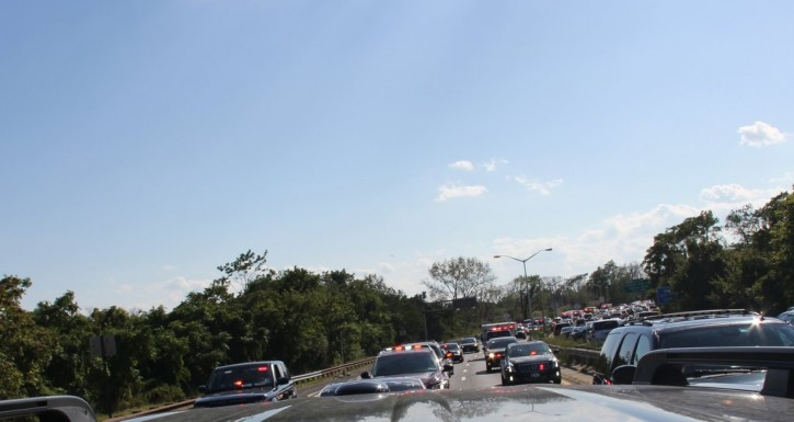 Emergency vehicle escort the casket of Zakheim on the Belt Parkway, on its way to JFK Airport. (Photo: Shimon Gifter-VINnews.com)