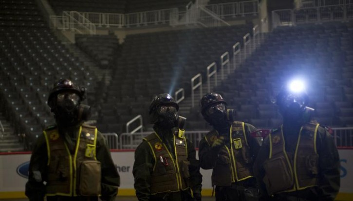 U.S. Marines survey the situation from the floor of the Barclays Center during a mock disaster drill in the Brooklyn borough of New York September 13, 2013. The United States Marine Corps and the Fire Department of New York held a simulation of two explosions during a basketball game that utilized chemical and nuclear contaminants.    REUTERS/Carlo Allegri