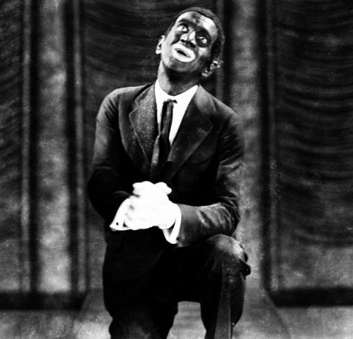 "FILE - This 1927 image originally released by Warner Bros., shows Al Jolson in blackface makeup in the movie ""The Jazz Singer."" Historically, blackface emerged in the mid-19th century, representing a combination of put-down, fear and morbid fascination with black culture. Among the most prominent examples: Al Jolson and Eddie Cantor. Today, there's a fine line between mockery and tribute. (AP Photo/Warner Bros.)"