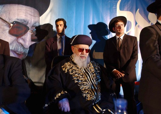 File - File photo of Rabbi Ovadia Yosef sits surrounded by members of his staff during a rally of his Ultra-Orthodox Shas party in Jerusalem.(AP Photo/Enric Marti, File)