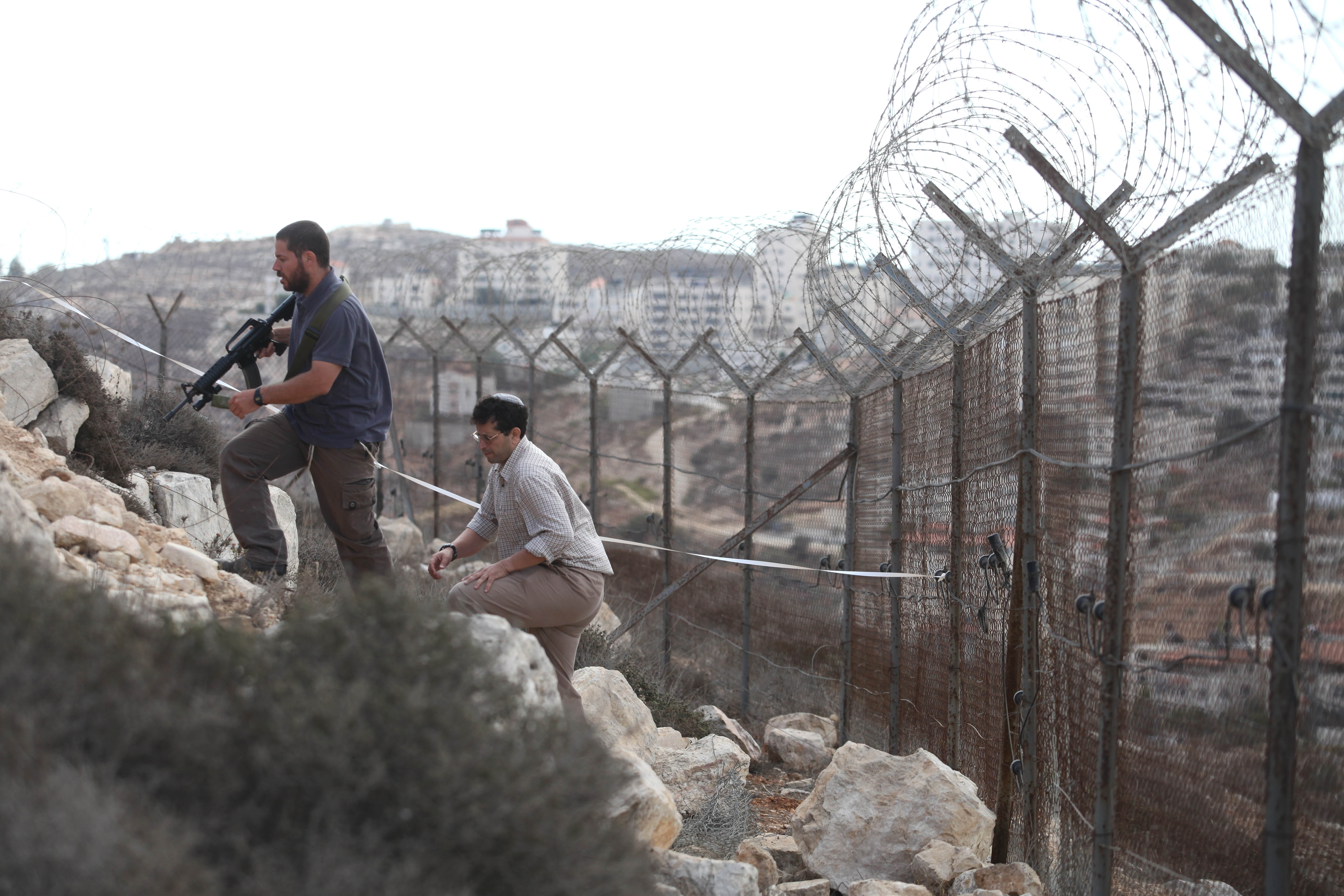 Israel army arrests two palestinian men suspected in