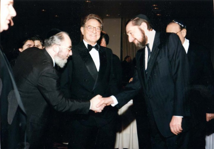 FILE - (L-R) Dr. David Moskovits,President Endowment for Democracy in Eastern Europe, George Soros, Moshe (Paul) Reichman Nov. 1993. This Historic photo taken at a private meeting in connection with the gala to benefit the Endowment for Democracy Dinner established by Dr. David Moskovits that honored George Soros who was at that time partners with Paul Reichmann whose brother Albert Reichmann chaired the Endowment, sponsors of the Masaros Avos School in Budapest, an initiative of the Skulener Rebbe Shlita. (Photo credit: The Friedlander Group)