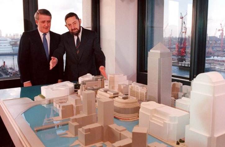AP FILE - Then Canadian prime minister Brian Mulroney, left, and Paul Reichmann, who died Friday, look at a model of the proposed Canary Wharf in London.