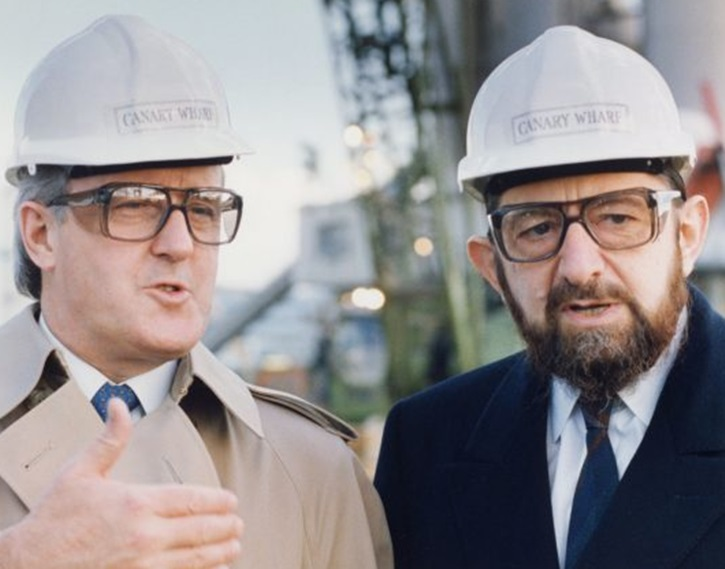 AP FILE - Then Canadian prime minister Brian Mulroney, left, and Paul Reichmann at the job site in 1989 of Olympia & York's vast Canary Wharf project in London.