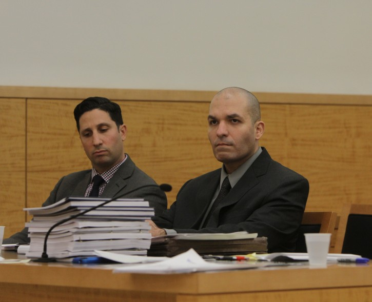 (PHOTO COURTESY TO VINnews.com) David Flores, 36, (Center) who is charged with attempted murder of Brooklyn Shomrim volunteers in September 2010 during a wild melee in Borough Park, sits at State Supreme Court on Nov. 26,. 2013 in Brooklyn for summations on his retrial.(NY DAILY NEWS)