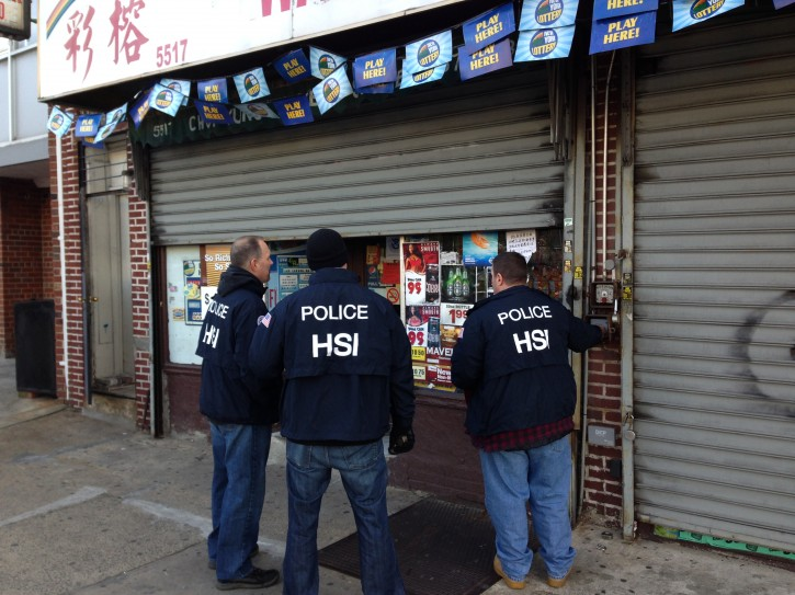 Homeland Security investigators stand in front of one of the Brooklyn Stores raided. The store located in Borough Park on Ft. Hamilton Parkway on 56 Street.(Arya Rabinovits/VINnews.com)