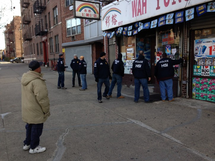 Homeland Security investigators on Nov. 20, 2013 stand in front of one of the Brooklyn Stores raided. The store located in Borough Park on Ft. Hamilton Parkway on 56 Street.(Arya Rabinovits/VINnews.com)