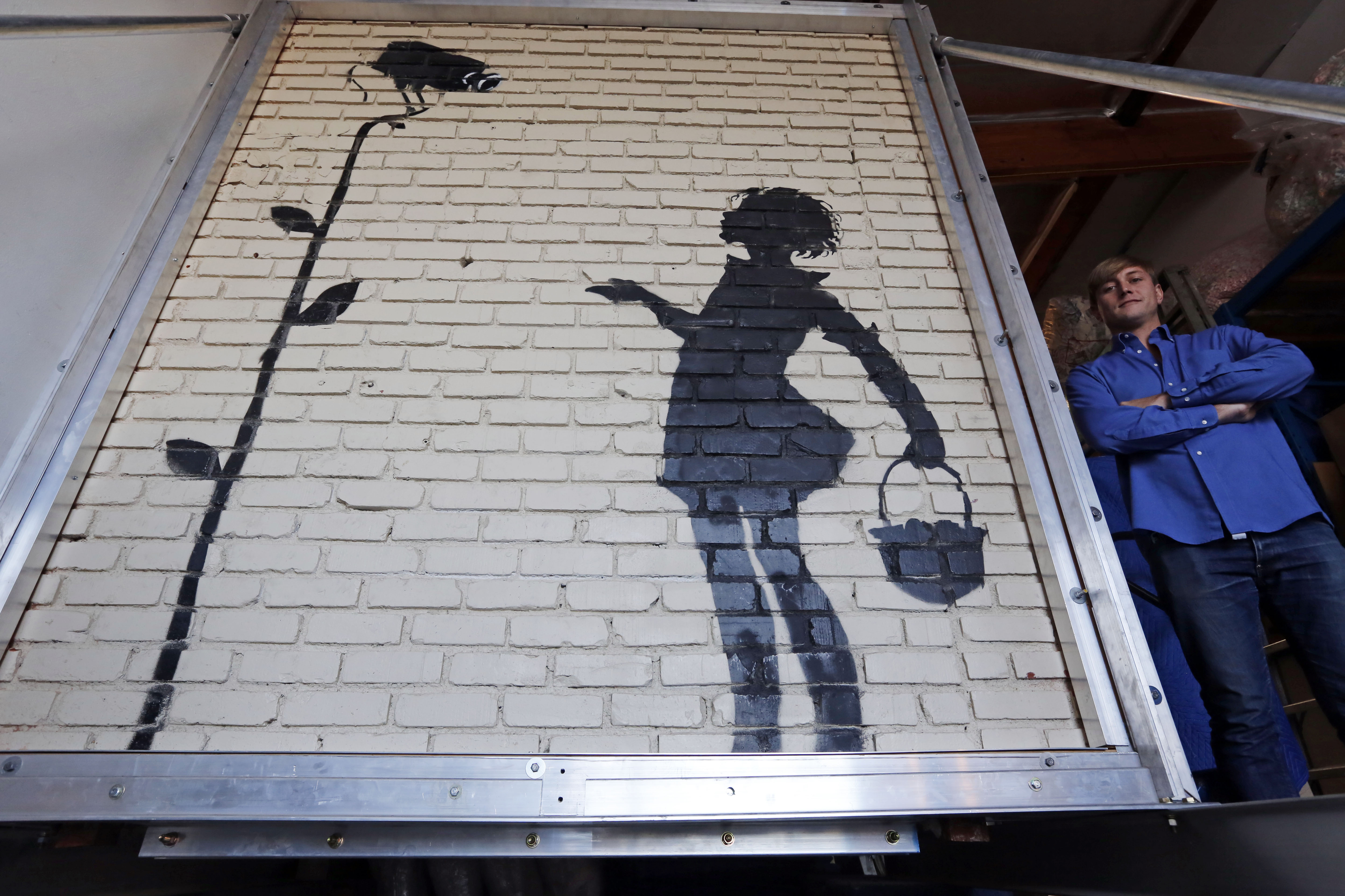 Beverly hills ca banksy mural fetches 209k at for Banksy mural sold