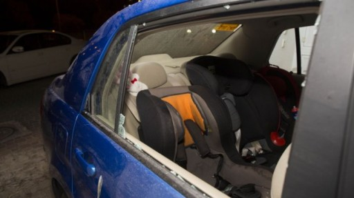 The car in which Avigail Ben Zion, 2, was injured by a stone near her home in Armon Hanatziv, Jerusalem, November 28, 2013. (Photo credit: Yonatan Sindel/Flash90)