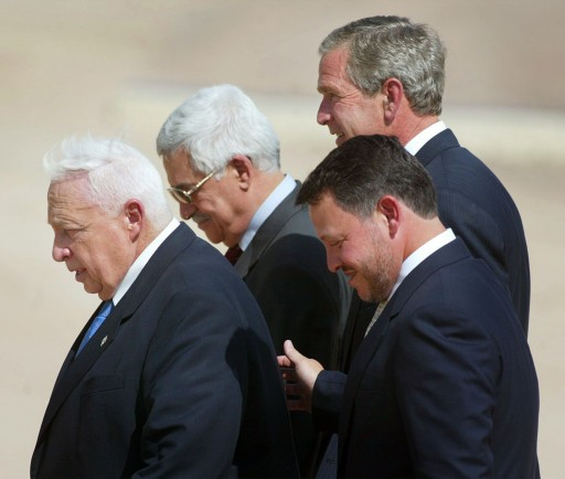 FILE - This Wednesday, June 4, 2003 file photo, from left to right shows, Israeli Prime Minister Ariel Sharon, Palestinian Prime Minister Mahmoud Abbas, King Abdullah of Jordan and President  Bush, walk off stage after making statements after their meeting at Beit al Bahar Palace, in Aqaba, Jordan. Sharon, the hard-charging Israeli general and prime minister who was admired and hated for his battlefield exploits and ambitions to reshape the Middle East, died Saturday, Jan. 11, 2014. The 85-year-old Sharon had been in a coma since a debilitating stroke eight years ago. (AP Photo/Pablo Martinez Monsivais, File)