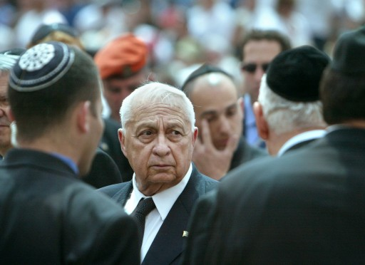FILE - In this Monday, April 26, 2004 file photo, Marking Israeli Memorial Day, Israeli Prime Minster Ariel Sharon greets family members of terror victims, after a memorial ceremony for Israeli civilians who have been killed since Israel's founding 56 years ago, at Mt. Herzl Cemetery, in Jerusalem. Sharon, the hard-charging Israeli general and prime minister who was admired and hated for his battlefield exploits and ambitions to reshape the Middle East, died Saturday, Jan. 11, 2014. He was 85. (AP Photo/Brennan Linsley, File)