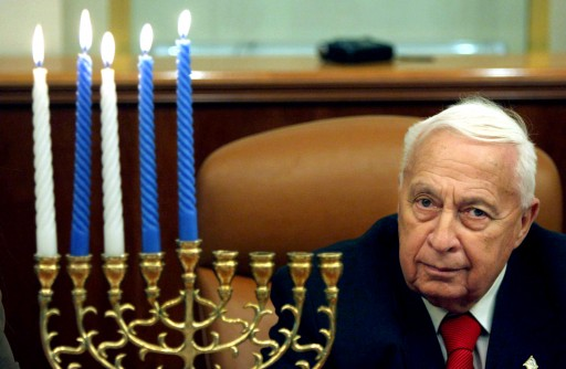 FILE - In this Tuesday Dec. 27, 2005 file photo, Israeli Prime Minister Ariel Sharon takes part in the lighting of the fourth Hanukkah candle, at his Jerusalem office. Sharon, the hard-charging Israeli general and prime minister who was admired and hated for his battlefield exploits and ambitions to reshape the Middle East, died Saturday, Jan. 11, 2014. He was 85. (AP Photo/Pavel Wolberg, Pool)