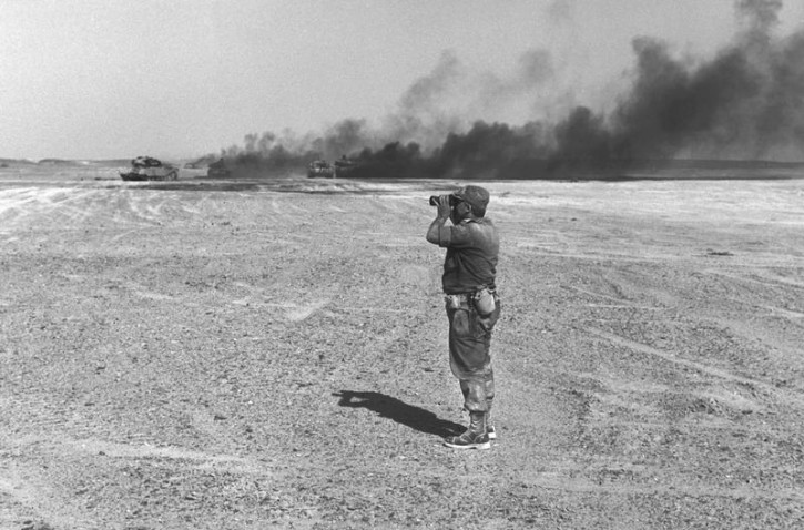 Israeli Major General Ariel Sharon watches an aerial drop through his binoculars June 8, 1967 in the Sinai Peninsula, then occupied by Israel, during the Middle East War in this handout photo released by the Government Press Office. Surgeons battled to keep Sharon alive on January 5, 2006 after a massive brain haemorrhage felled the Israeli prime minister in the midst of his fight for re-election on a promise to end conflict with the Palestinians. Reuters