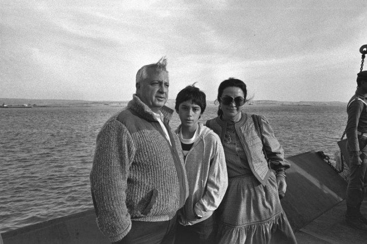 Israeli Defence Minister Ariel Sharon (L) stands with his wife Lily (R) and their son while visiting the Suez Canal area, Egypt, January 19, 1982 in this handout photo released by the Government Press Office. Surgeons battled to keep Sharon alive on January 5, 2006 after a massive brain haemorrhage felled the Israeli prime minister in the midst of his fight for re-election on a promise to end conflict with the Palestinians.  Reuters