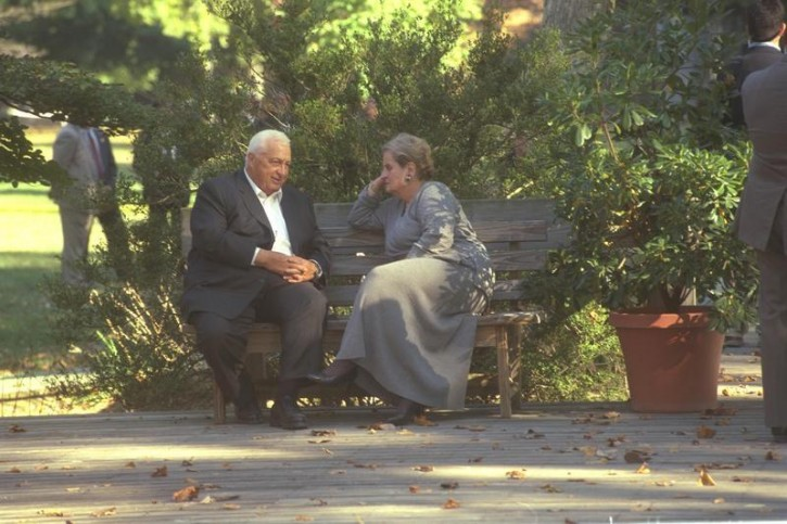 Israel's Foreign Minister Ariel Sharon (L) sits on a bench with U.S. Secretary of State Madeleine Albright during the Middle East peace summit at the Wye River Conference Centre in this handout file picture taken October 18, 1998 and released by the Israeli Government Press Office (GPO). REUTERS/Avi Ohayon/GPO/Handout/Files