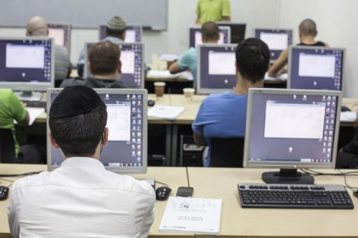 FILE - An ultra-Orthodox Jewish man attends a computer course. Reuters