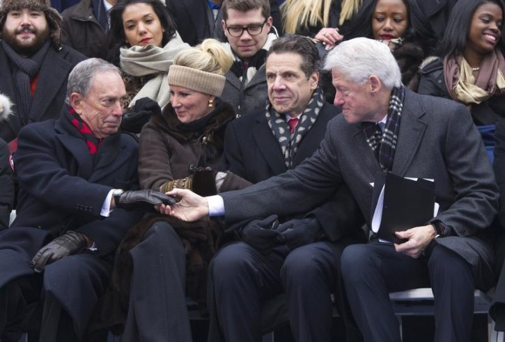 ormer U.S. President Bill Clinton (R) offers his hand to former New York City Mayor Michael Bloomberg (L) after acknowledging him in his speech during the inauguration ceremony for New York City Mayor Bill de Blasio in New York on January 1, 2014. Reuters