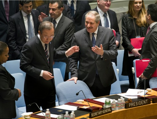 Jordanian Foreign Minister and President of the United Nations Security Council Nasser Judeh, right, has a conversation with U.N. Secretary-General Ban Ki-moon as the Security Council meeting began at U.N. headquarters, Monday, Jan. 20, 2014.(AP Photo/Craig Ruttle)