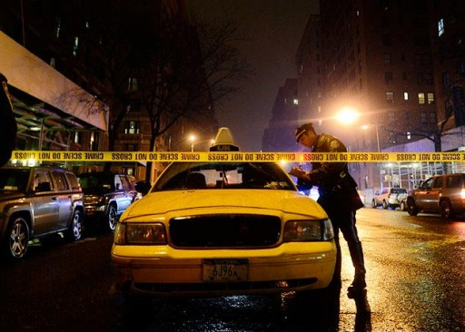 Police question the Taxi driver Friday night Jan. 10, 2014. (PHOTO COURTESY TO VINnews.com- PEARL GABEL/NEW YORK DAILY NEWS)