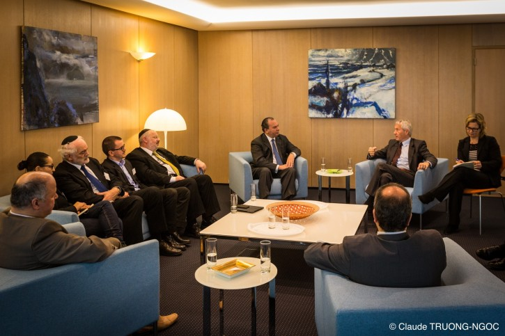 Rabbi Marc Schneier (center) in discussion with Council of Europe Secretary General Thorborn Jagland as European Muslim and Jewish leaders look on in a meeting at the Strasbourg headquarters of the Council of Europe.